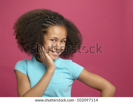 African girl with hand on cheek - stock photo