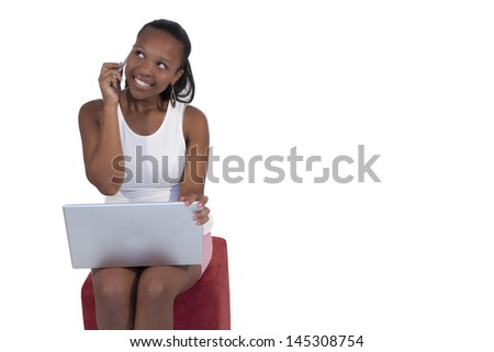 African girl with mobile phone and laptop on white background - stock photo