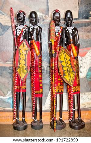 African handcraft dark wood carved people figures. Kenya, Africa. - stock photo