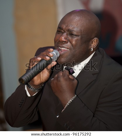 African male giving a live soul singing performance