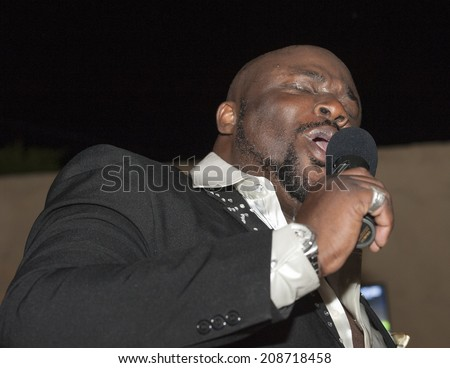 African male singer giving a live soul singing performance