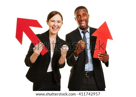 African man and caucasian woman cheering for motivation with red arrows