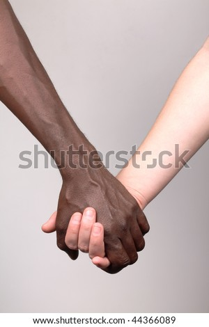African man and white woman holding hands