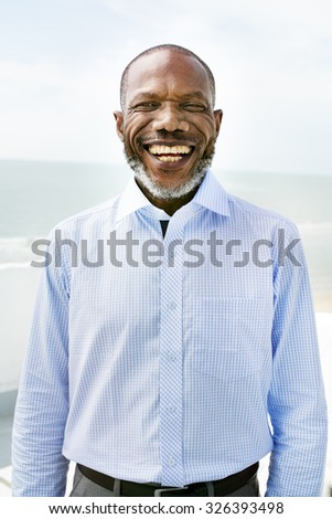 African Man Beach Vacation Lifestyle Portrait Concept - stock photo