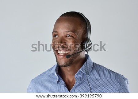 African man customer service personnel operator smiling with microphone headset