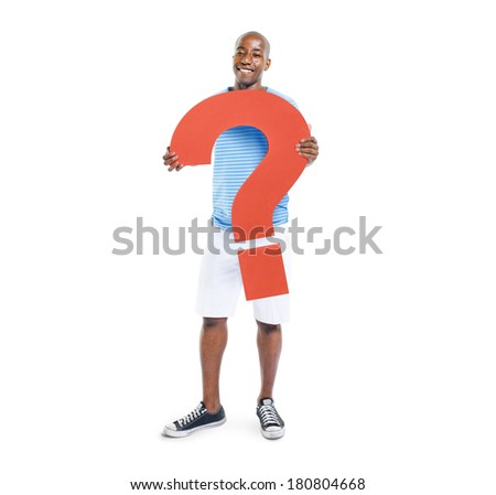 African Man Holding Question Mark Symbol - stock photo