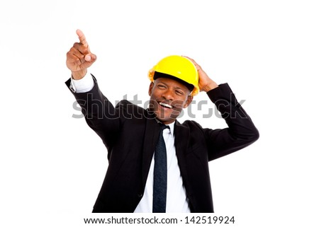 African man in hard hat looking to the future shot in studio