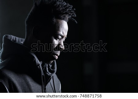 African man profile portrait in dark
