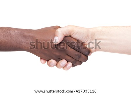 African man's hand shaking white man's hand, isolated on white background - stock photo