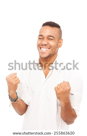 African man smiling and making fist gesture of happiness over white isolated background - stock photo