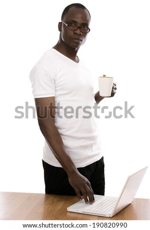 African man with cup of tea, isolated on white background - stock photo