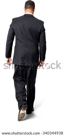 African man with short black hair in evening outfit walking - Isolated