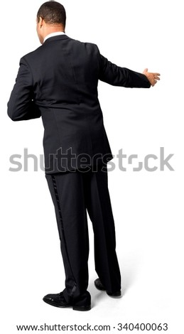 African man with short black hair in evening outfit with hands on stomach - Isolated