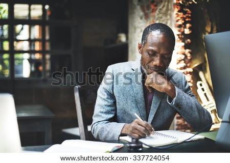 African Man Working Determine Workspace Lifestyle Concept - stock photo