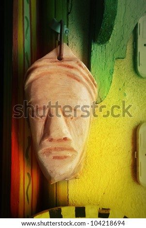 African mask on wall - stock photo