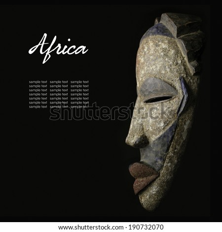 African mask over black background - stock photo
