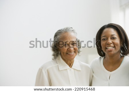 African mother and adult daughter - stock photo