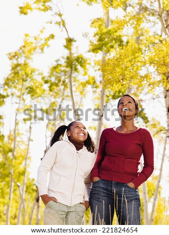 African mother and daughter in woods - stock photo