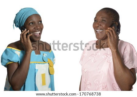 African mother and daughter talking on cellphone, Studio Shot - stock photo