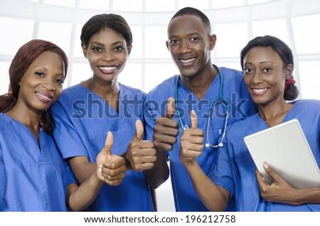 African physician team thumbs up, Studio Shot - stock photo
