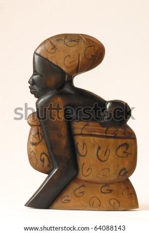 African sculpture of a mothe - stock photo