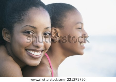 African sisters hugging - stock photo