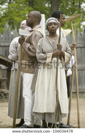 African slave reenactors posing as part of the 400th anniversary of the Jamestown Colony, Virginia, attended by Her Majesty Queen Elizabeth II at the James Fort, Jamestown Settlement, May 4, 2007 - stock photo