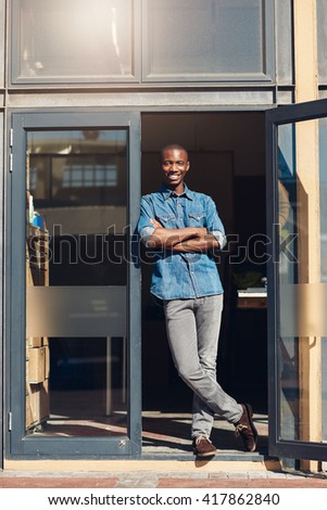 African small business owner in the doorway of his studio - stock photo