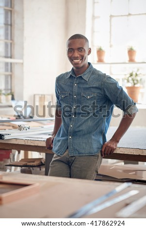 African small business owner standing in his beautifully lit studio - stock photo