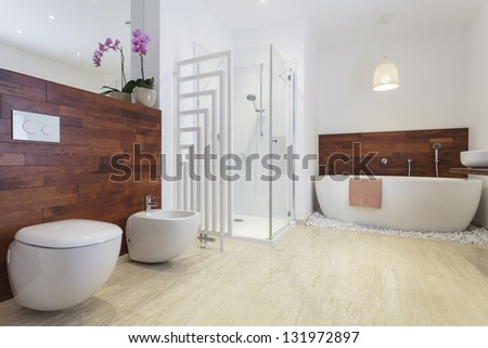 African style bathroom with exotic wood and free standing bath.