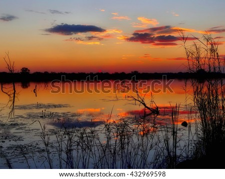 african sunset over water