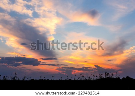 African sunset with dramatic clouds on sky, Kavango Namibia - stock photo