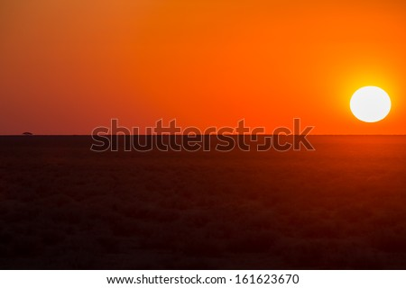 African sunset with that round sun - stock photo
