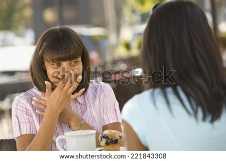 African teenaged girl talking to friend