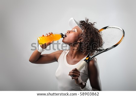African tennis player drinking energy drink