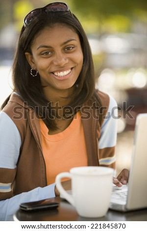 African woman at outdoor cafe - stock photo