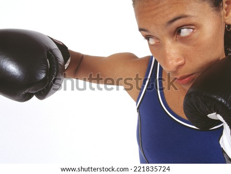 African woman boxing - stock photo
