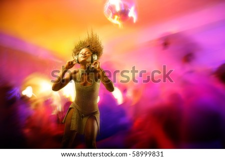 African woman dancing to the music in a disco - stock photo