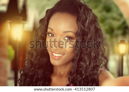 African woman doing selfie