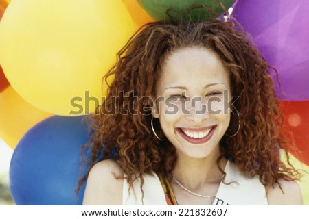 African woman in front of balloons