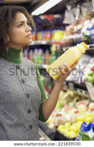 African woman in grocery store - stock photo