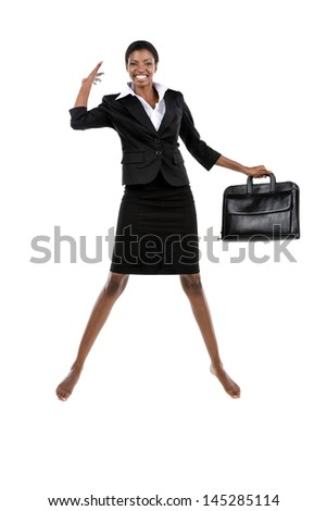 African woman in suit jumping with briefcase