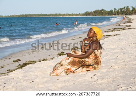 African woman looking interested to the sea. - stock photo