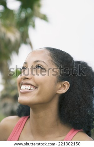 African woman looking up - stock photo