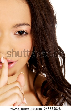 African woman making a hush gesture. - stock photo
