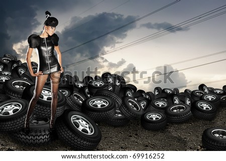 African woman on tires - stock photo