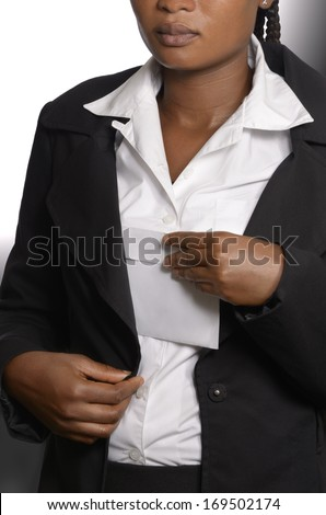 African woman putting bribe in jacket, Studio Shot - stock photo