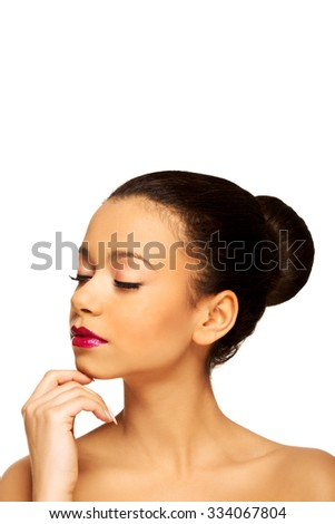 African woman with make up and eyes closed.
