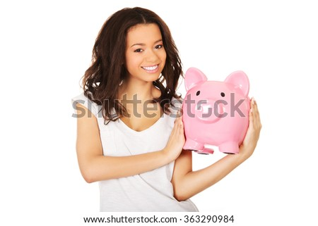 African woman with piggybank.