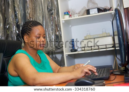African woman work with computer in office - stock photo